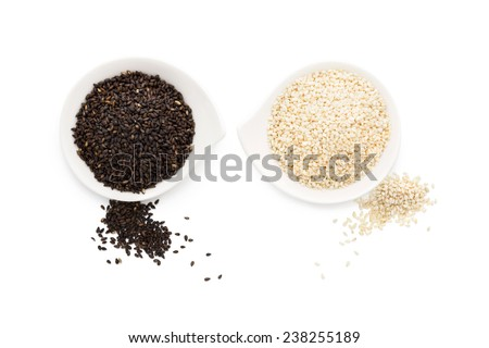 Black and white sesame seeds isolated on white background. Healthy eating. - stock photo