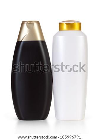 black and white shampoo bottles isolated on white - stock photo