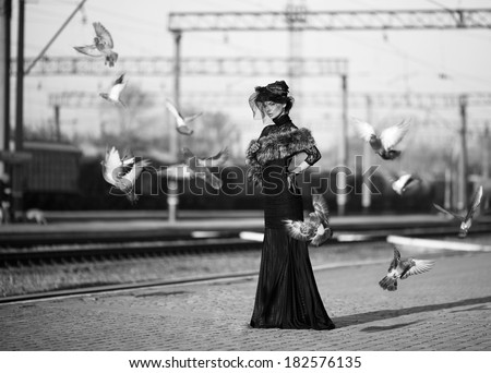 Black and white shoot of woman on train station - stock photo