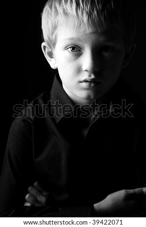 Black and White Shot of a Sad Blonde Boy - stock photo