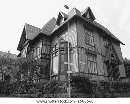 Black and white shot of a traditional wooden house.  Norwegian architecture in Bergen - Norway