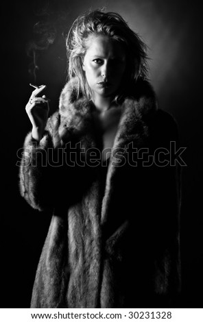 Black and White Shot of a Vintage Styled Woman Holding a Cigarette - stock photo