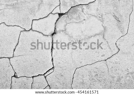 black and white shot of cracked concrete wall texture background