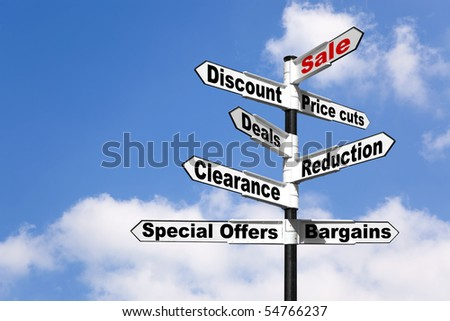 Black and white signpost with the words Sale, Discount, Price cuts, Deals, Reduction, Clearance, Special offers and Bargains against a blue cloudy sky. Good image for retail themes. - stock photo