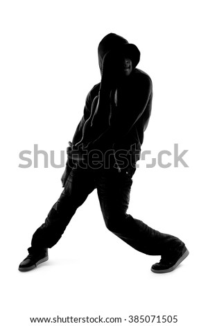 Black and white silhouette of a male dancer posing with dance moves.  He is backlit and in shadow to show off his body poses.