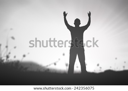 Black and white, silhouette of man with hands raised to beautiful autumn sunset background. A disabled man standing up. Positive Cure Recovery Medical Miracle Hope Insurance Hallelujah concept. - stock photo