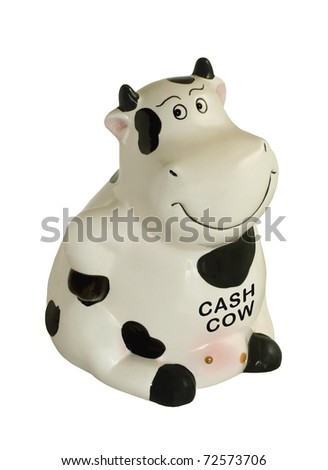 Black and white sitting cow piggy bank isolated on white. - stock photo
