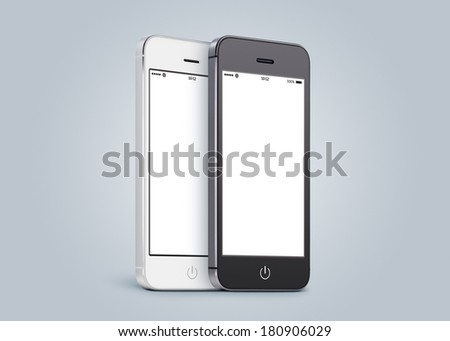 Black and white smartphones are close to each other in half turn and rotated at a slight angle on gray gradient background.  - stock photo