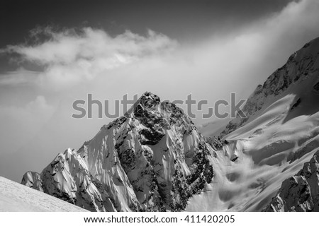Black and white snowy mountains. Caucasus Mountains, region Dombay. View from ski slope.