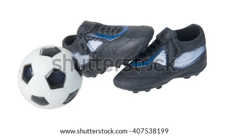 Black and white soccer ball with black and white shoes - path included - stock photo