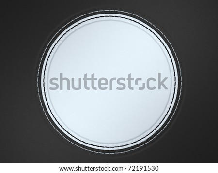 Black and white stitched circle shape on leather background. Large resolution