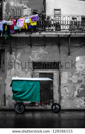 Black and white street scene in Old Havana with some color details - stock photo