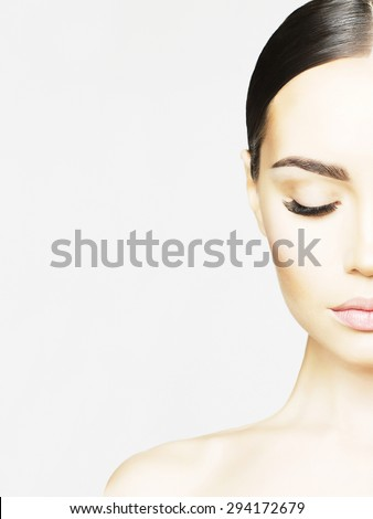 Black and white studio portrait of beautiful young woman. Beauty and care. Extension eyelashes. Spa salon - stock photo
