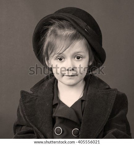 black and white stylized retro portrait of a child girl - stock photo