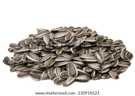 Black and white sunflower seeds isolated on white background - stock photo