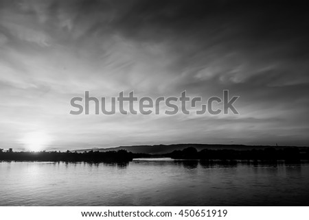 black and white sunset on river at evening
