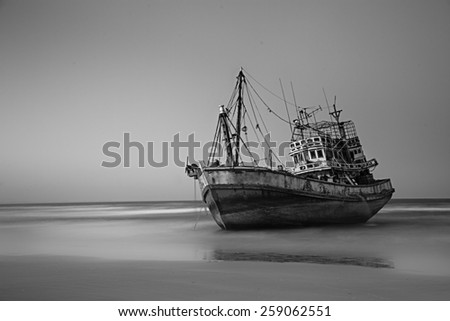 black and white sunset with wooden fishing boat in Thailand