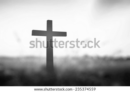 Black and white the cross on blurred sunset background. Responsibility, Worship, Forgiveness, Repentance, Reconcile, Adoration, Glorify, Redeemer concept. - stock photo
