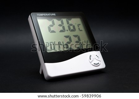 Black and white thermometer on black background. - stock photo