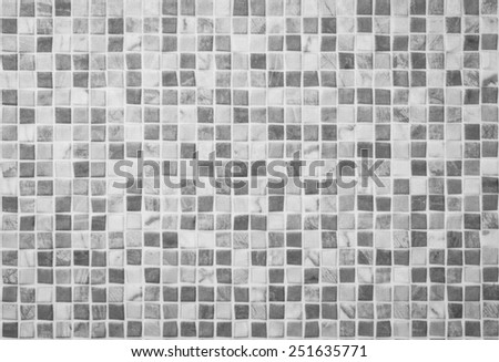 Black and White tile wall. - stock photo