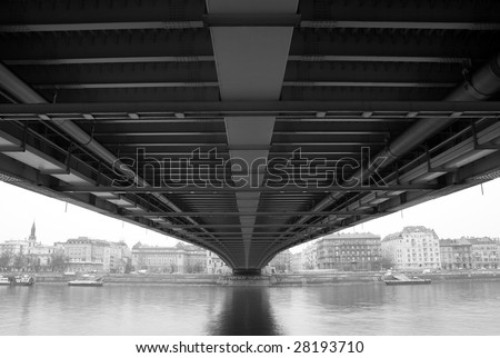 Black and white townscape from under the bridge - stock photo