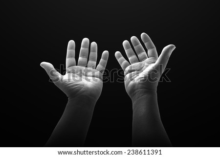 Black and white two open empty hands with palms up. - stock photo