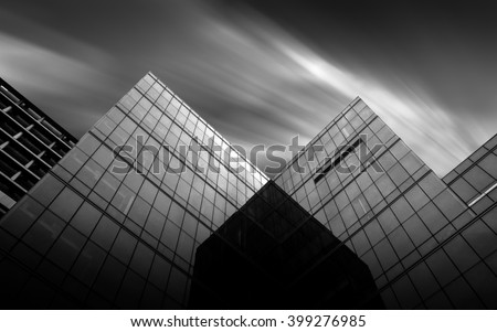 Black and white urban geometry  glass building  - stock photo