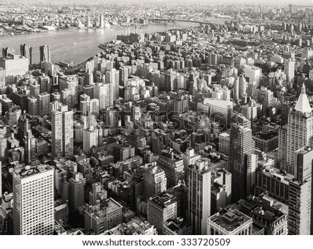 Black and white urban landscape of New York City with the East River on the background - stock photo