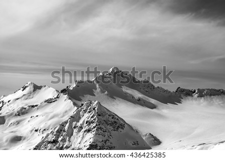 Black and white view from the ski slope on Mount Elbrus at sun evening. Caucasus Mountains. - stock photo