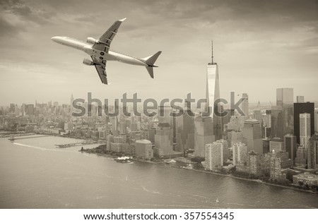 Black and white view of airplane over New York City. Tourism concept.