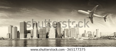 Black and white view of airplane over New York City. Tourism concept. - stock photo