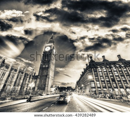 Black and white view of Westminster traffic at night, London. - stock photo