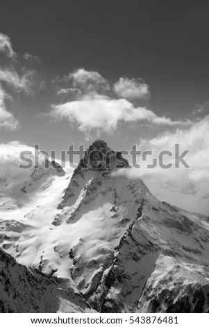 Black and white view on high winter mountains in snow. Caucasus Mountains, region Dombay, Mount Belalakaya.