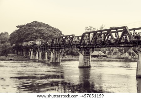 Black and white vintage photo style trains for travel running on the old bridge over the River Kwai is a historical attractions during World War 2 the famous of Kanchanaburi Province in Thailand - stock photo