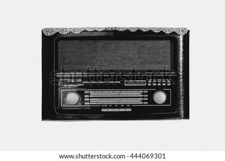 Black and white vintage radio on white background, filtered color tone
