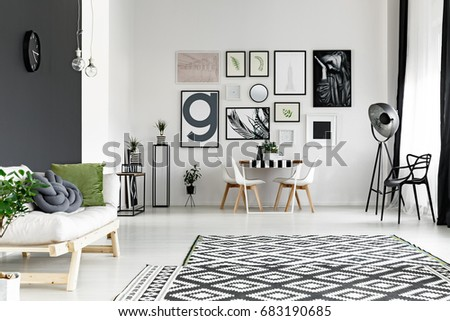 Black And White Walls In Spacious Living Room With Dining Table Part 91