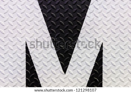 black and white warning sign on diamond steel plate