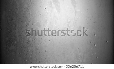Black and white wet glass ambient background. - stock photo