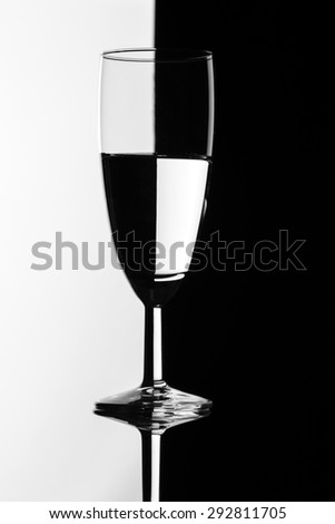 Black and white wine glass on isolated background - stock photo