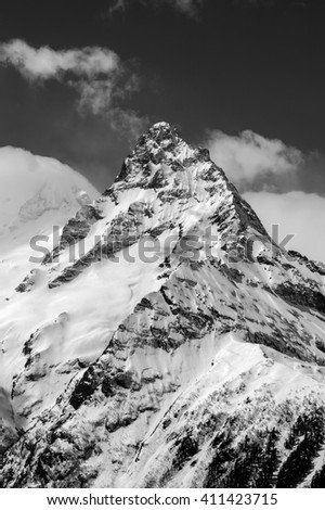 Black and white winter mountains. Caucasus Mountains, region Dombay, Mount Belalakaya. - stock photo