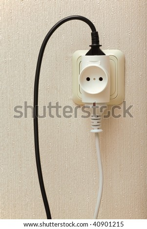 Black and white wires in a wall outlet.