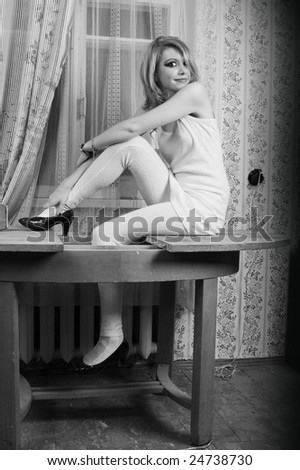black and white woman on a table