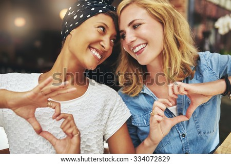 Black and white women, best friends, on a cafe
