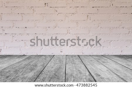 Black and white wooden table top with brick wall decorated in coffee shop