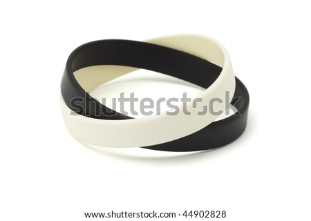 Black and white wrist bands on white background - stock photo