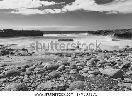 Black and whitelLong exposure of sea and rocks in Tenerife, Spain - stock photo