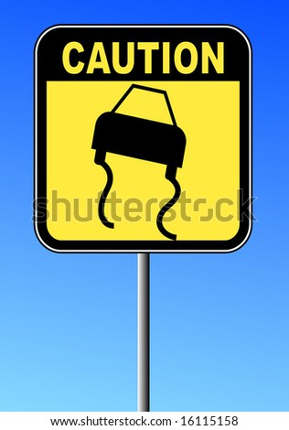 black and yellow caution sign against blue sky - road slippery - stock photo