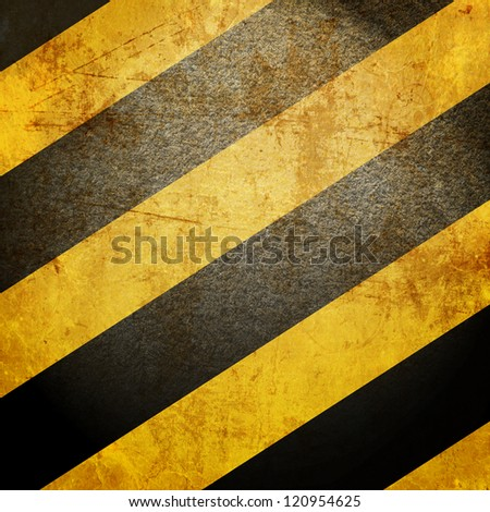 Black and yellow hazard lines with grunge effects - stock photo