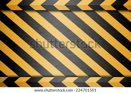 Black and yellow lines on a metal  plate  background  - stock photo