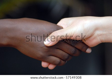 Black and yellow race of people shaking hands